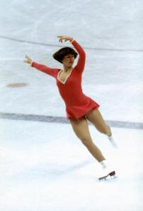 INNSBRUCK, AUS - 1976:  Dorothy Hamill skates on right skate with both arms posed above her head and left leg back during the Winter Olympics skating competition in 1976 in Innsbruck,  Austria. Dorothy Hamill wins the gold medel for the USA in the Womes Figure skating competition. (Photo by Tony Duffy/Getty Images)